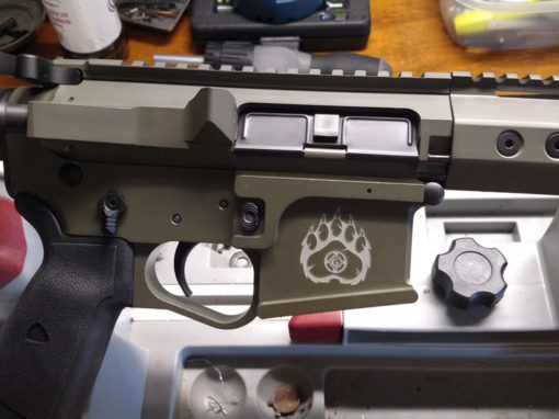 Custom Cerakoted AR with Grizzly Guns logo