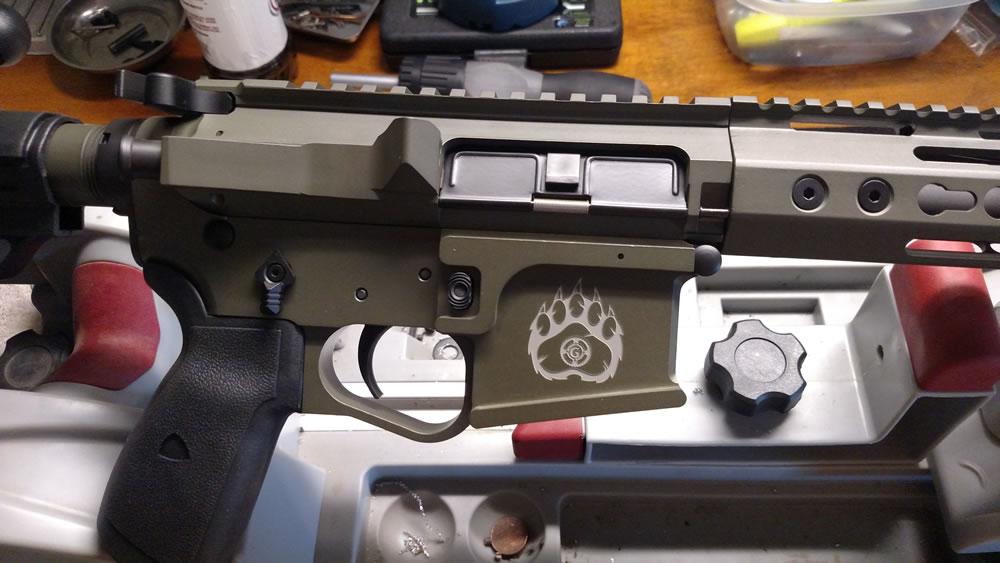 Custom Cerakoted AR with Grizzly Guns logo